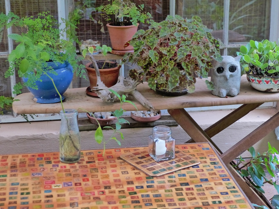 Repurposed ironing board and postage stamps
