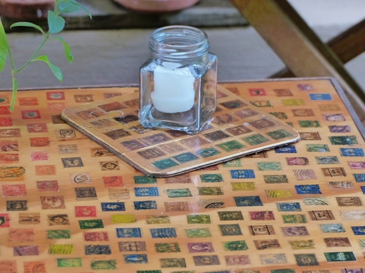 Repurposed postage stamps on table top