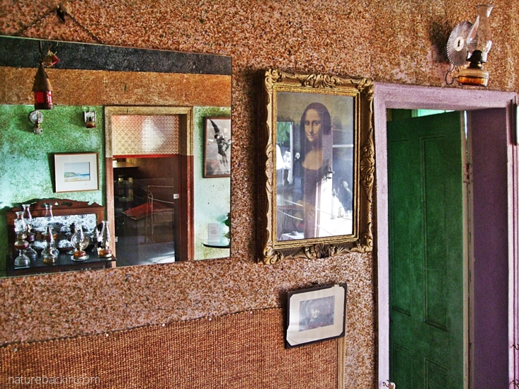 Interior room, Helen Martins' Owl House, with mirror, lamps and Mona Lisa, South Africa