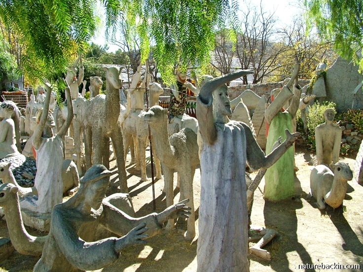 Procession of sculptured figures facing East, Camel Yard at the Owl House, South Africa