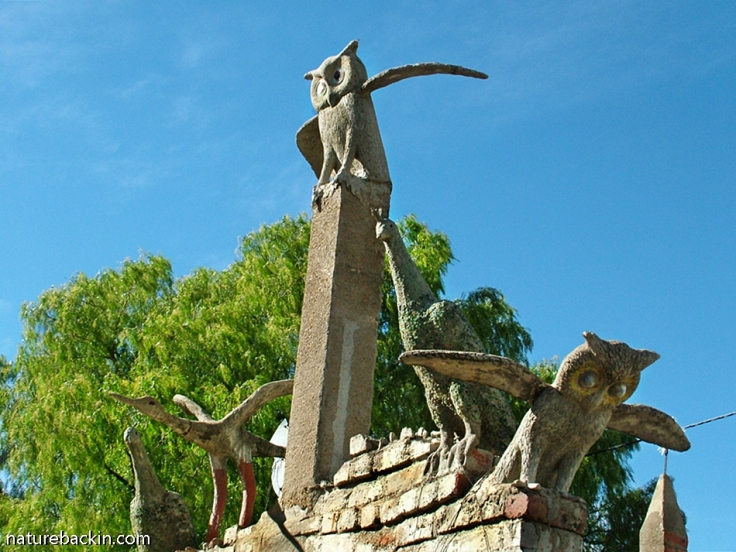 Tall sculpture with owls and other birds, Camel Yard at the Owl House, South Africa