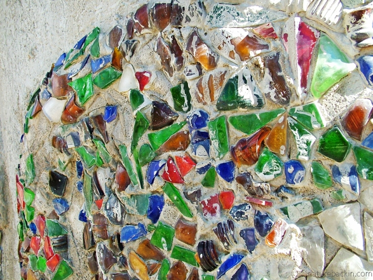 Glass fragments embedded in concrete embellish a sculpture at Helen Martins' Owl House, South Africa