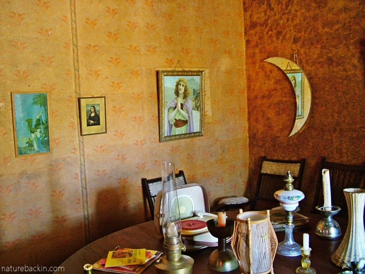 Room in Helen Martin's Owl House with mirror, lamps, candles, Nieu Bethesda