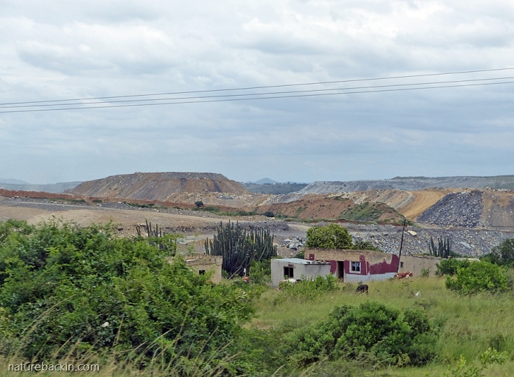 Dumps near house at Somkhele opencast coal mine, KwaZulu-Natal