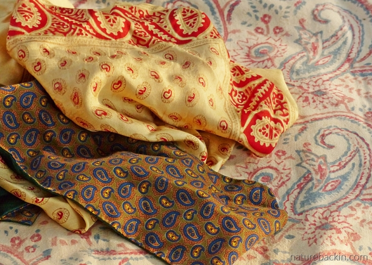 Paisley pattern on cravat, silk pocket square and block-printed cotten