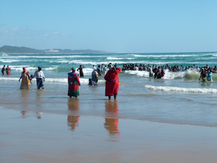 African Zionist church group entering the sea at Sodwana Bay, KwaZulu-Natal