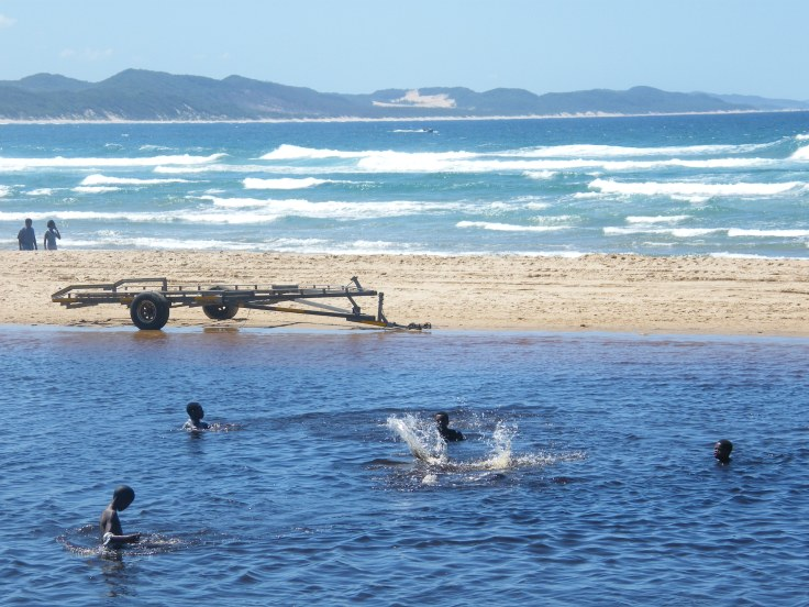 Children swimming in the lagoon at Sodwana Bay