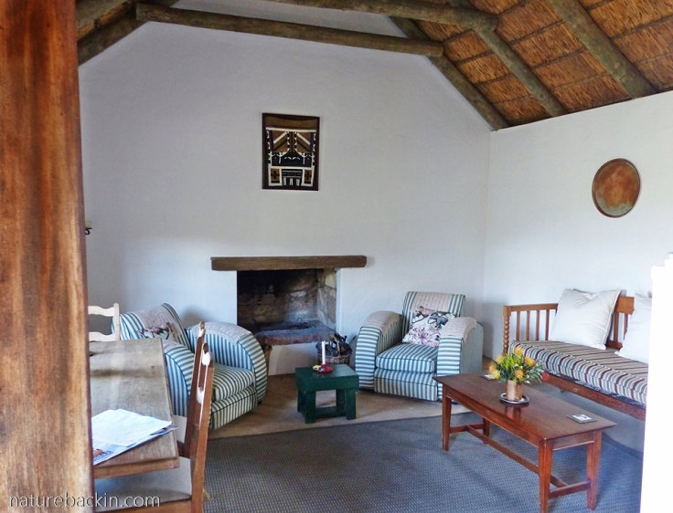 Sitting area in Cape-style cottage accommodation at Wild Rescue Nature Reserve, Western Cape