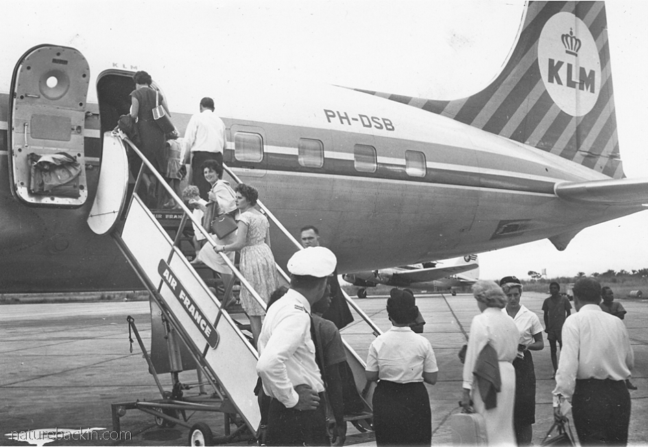 Boarding an airplane, 1960